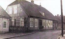 -99- Wohn- und Geschäftshaus Wilhelm Stüve, links die Schmiede von Fette, vor 1912